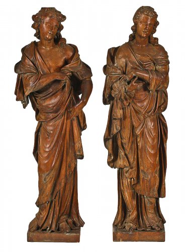 Pair of oak figures of angels or virtues, c. 1700