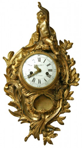 A Louis XV ormolu gilt bronze cartel clock