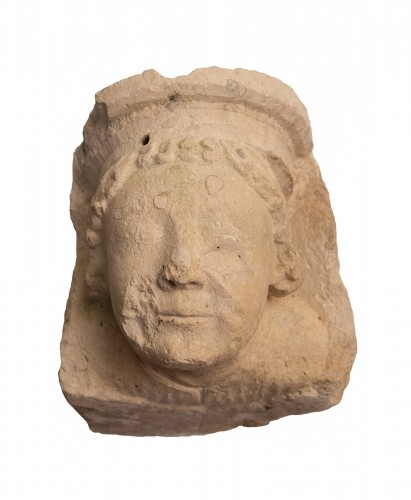 Capital with monk's head in limestone, Bourges 13th century