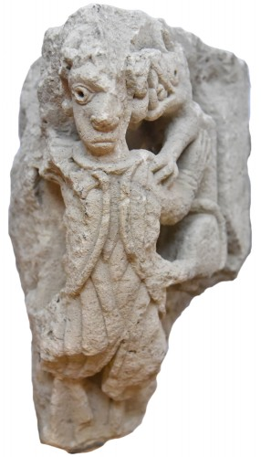 Sculpture  - Romanesque sculpture representing a harpy devoured by a wolf, France 1150