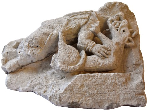 11th to 15th century - Romanesque sculpture representing a harpy devoured by a wolf, France 1150