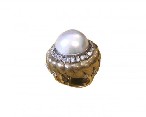 Ring with a MABE pearl and diamonds .