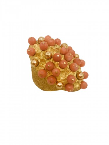 Gold and coral angel skin ring .