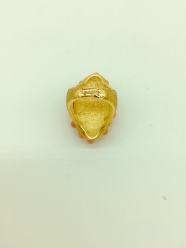 Gold and coral angel skin ring . -