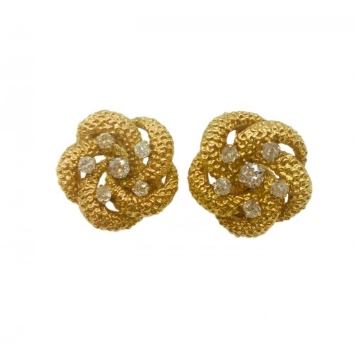A pair of diamond and gold earclips : by VAN CLEEF and ARPELS
