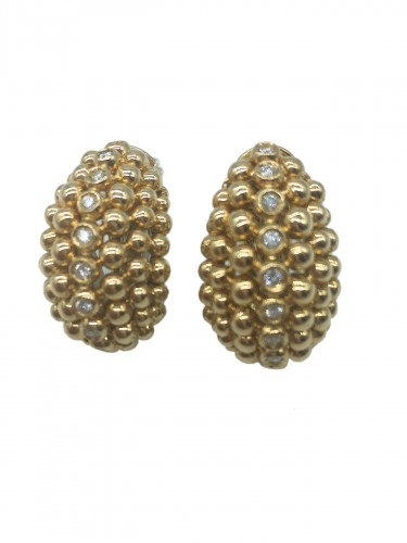 A diamond and gold pair of ear clips by FRED PARIS