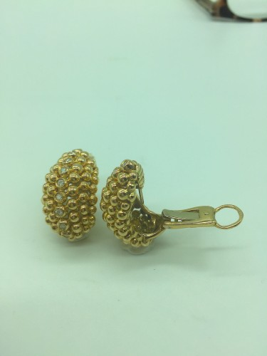 A diamond and gold pair of ear clips by FRED PARIS  - Antique Jewellery Style