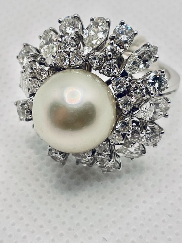 Antique Jewellery  - Gold ring center south sea pearl surrounding by diamonds .