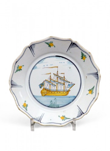 A Louis XV faience plate from Nevers