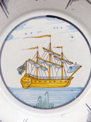Porcelain & Faience  - A Louis XV faience plate from Nevers