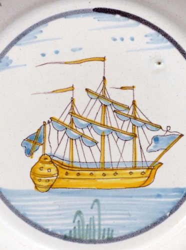 A Louis XV faience plate from Nevers -
