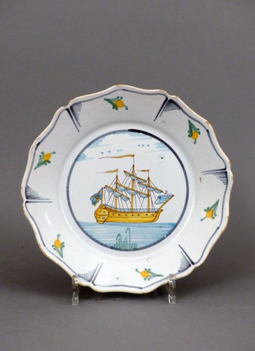 A Louis XV faience plate from Nevers - Louis XVI
