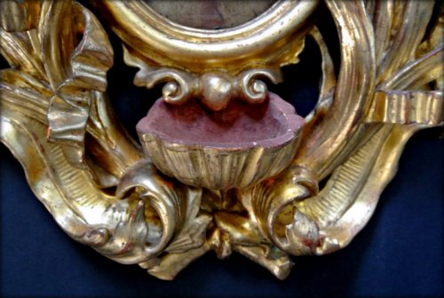 A XVIIIth century giltwood holy water stoup -