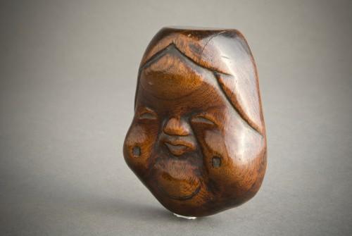 A Japanese boxwood Okame - Asian Art & Antiques Style