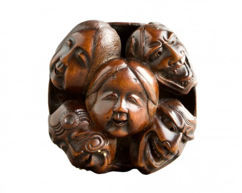 A Japanese netsuke of N?h and Kyogen theatre masks