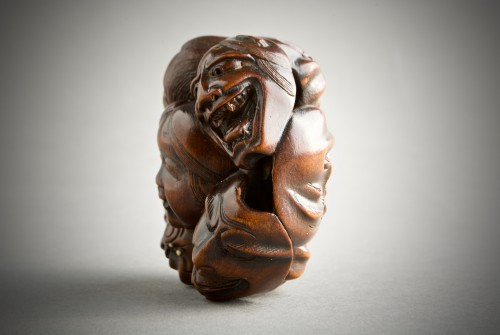 A Japanese netsuke of N?h and Kyogen theatre masks -
