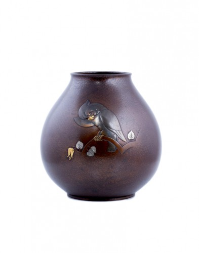 A Japanese bronze vase of a parrot