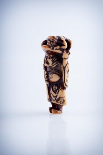 A Japanese ivory netsuke of a Shoki - Asian Art & Antiques Style