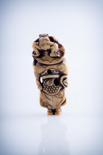 Asian Art & Antiques  - A Japanese ivory netsuke of a Shoki
