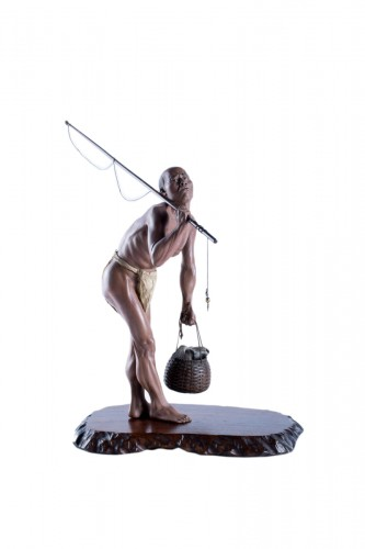 A Japanese Iki-ningy? sculpture okimono of a fisherman