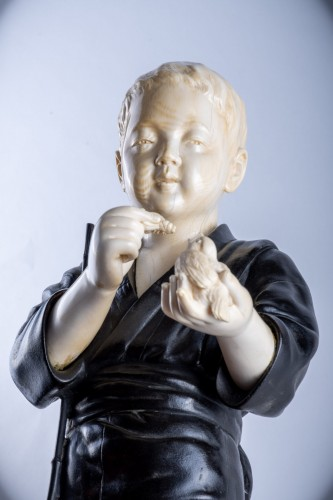 Asian Works of Art  - Hiroko - A Japanese Tokyo school ivory and bronze okimono of a child
