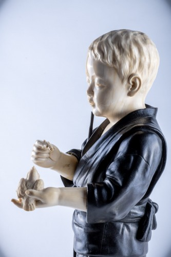 Hiroko - A Japanese Tokyo school ivory and bronze okimono of a child -