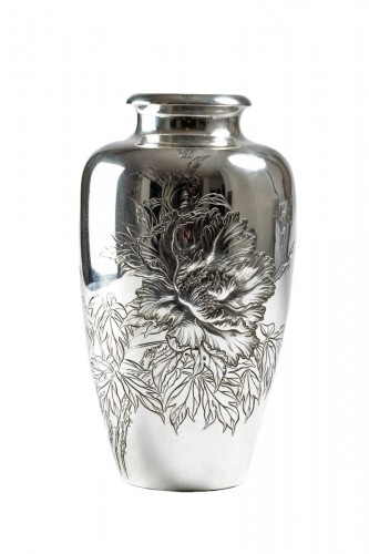 A Japanese silver vase