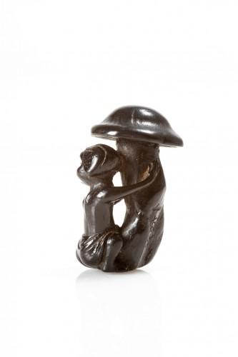 Asian Works of Art  - Tomotsugu - A Japanese Okame with mushroom