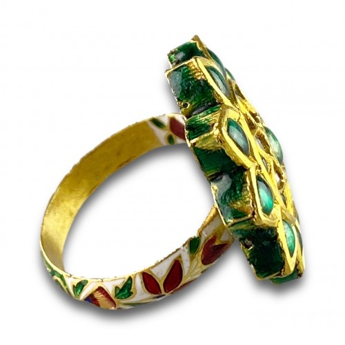 A foiled emerald, paste & enamel ring. Indian, early 20th century. -