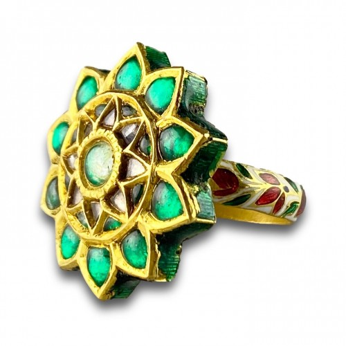- A foiled emerald, paste & enamel ring. Indian, early 20th century.