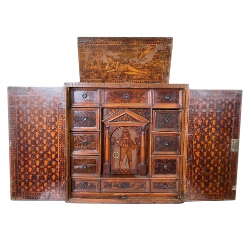 Cypress wood pyrography cabinet. North Italian, late 16th century.