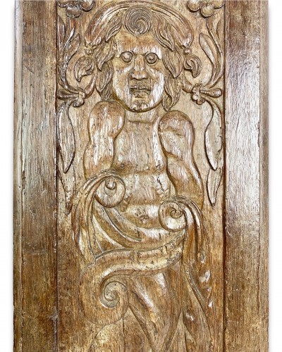 A large oak relief of a grotesque figure. French, dated 1660. -