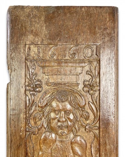 17th century - A large oak relief of a grotesque figure. French, dated 1660.