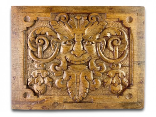 Pair of walnut panels carved with mascarons. French, late 16th century.