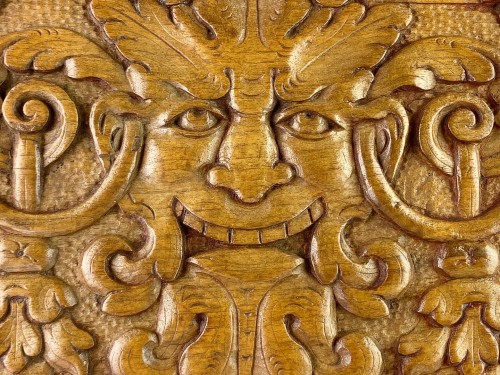 Architectural & Garden  - Pair of walnut panels carved with mascarons. French, late 16th century.