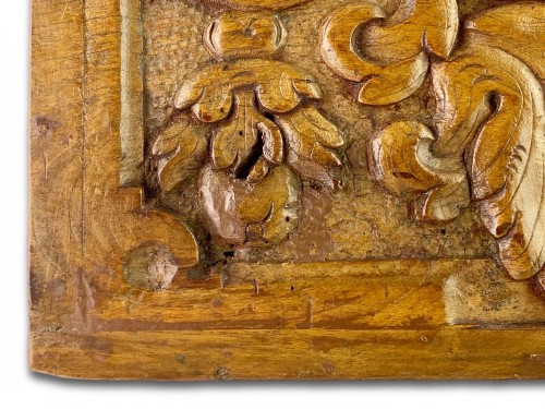 Pair of walnut panels carved with mascarons. French, late 16th century. -