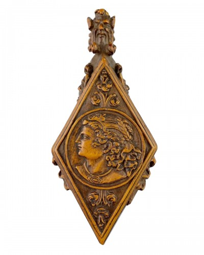 Fruitwood flask with portraits & beasts. French, late 16th century.
