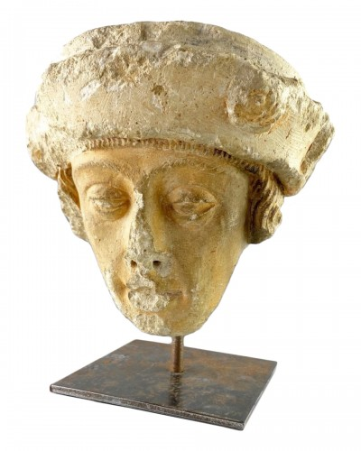 A stone head of a male saint. Champagne, late 15th century.
