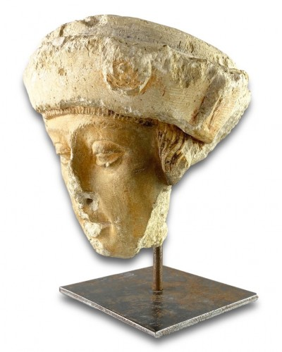 A stone head of a male saint. Champagne, late 15th century. -