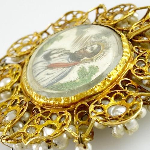 - Gold & pearl pendant with sleeping Christ child. Spanish, 18th century.