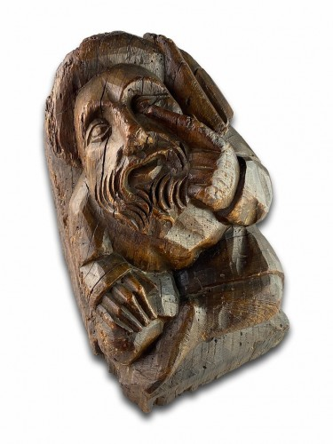Corbel of a seated man in fashionable clothing. Northern France, 15th centu