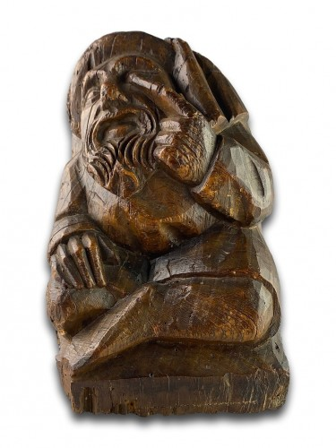 Sculpture  - Corbel of a seated man in fashionable clothing. Northern France, 15th centu