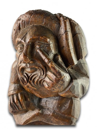 Corbel of a seated man in fashionable clothing. Northern France, 15th centu -