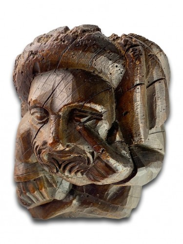 - Corbel of a seated man in fashionable clothing. Northern France, 15th centu