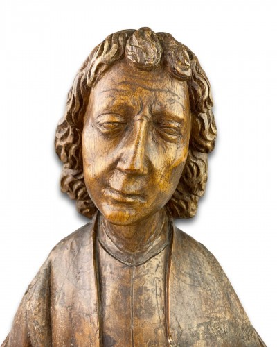 Antiquités - Oak bust of Saint John the Evangelist. French, 15th century.