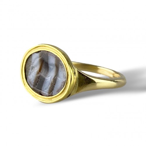 - Ring with a Roman banded agate intaglio of an Antelope. 2nd-1st century BC.