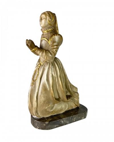 Alabaster relief of a kneeling female mourner, France 16th century.