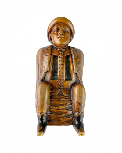 Fruitwood snuff box carved as a coachman relieving himself. Dutch, c.1780