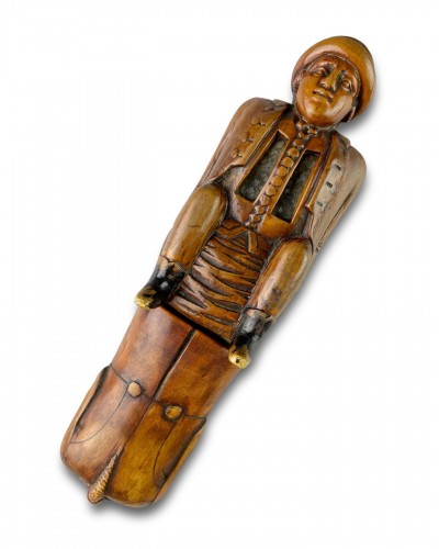 Objects of Vertu  - Fruitwood snuff box carved as a coachman relieving himself. Dutch, c.1780