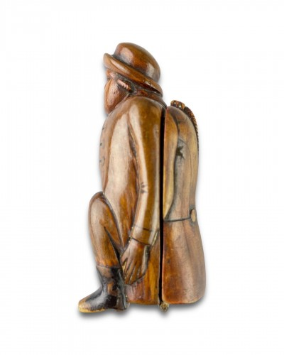 - Fruitwood snuff box carved as a coachman relieving himself. Dutch, c.1780